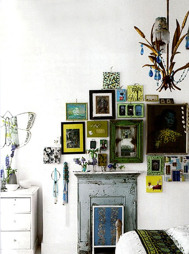 gallery wall inspiration with emerald green distressed frames