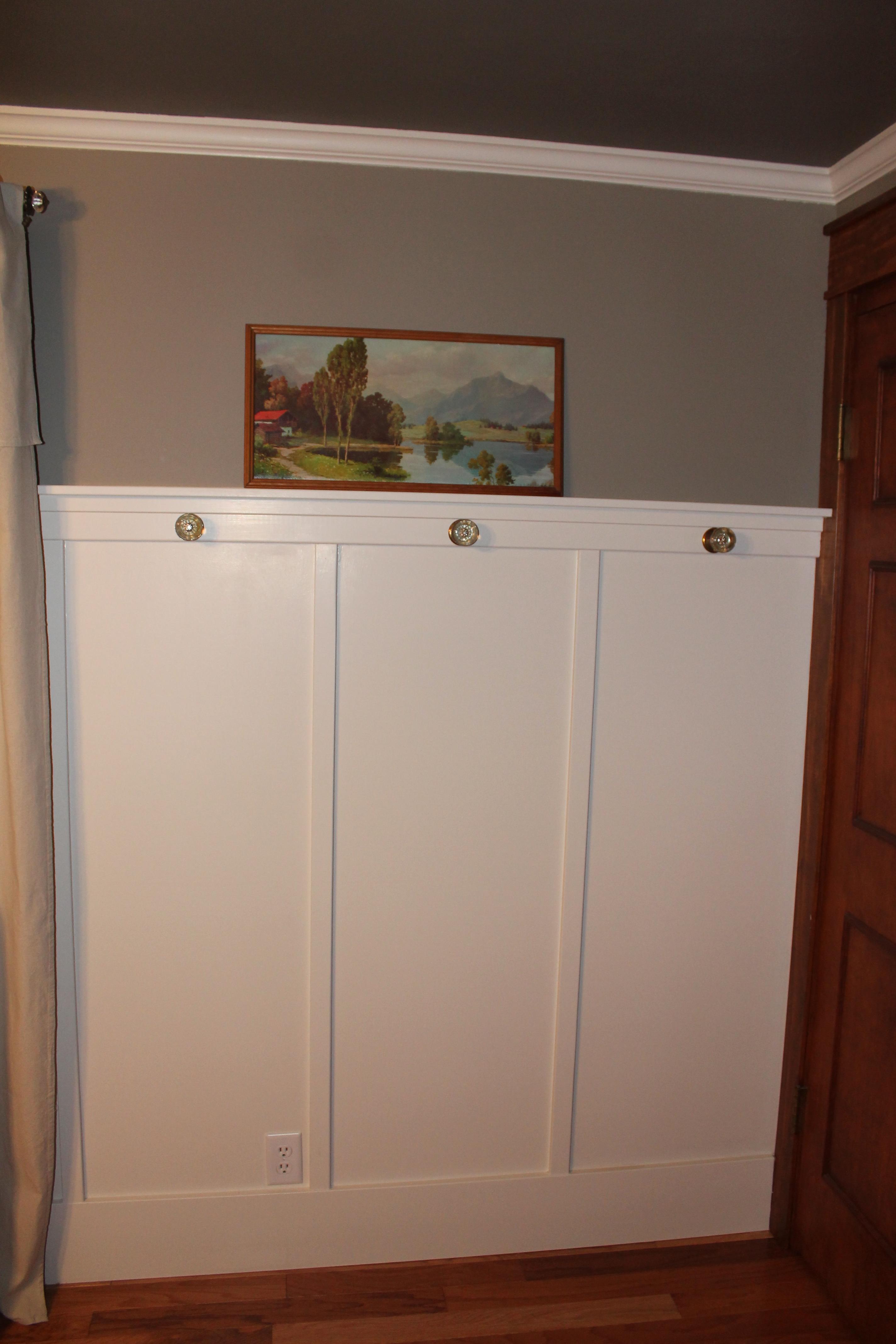 antique doorknob hooks on board and batten