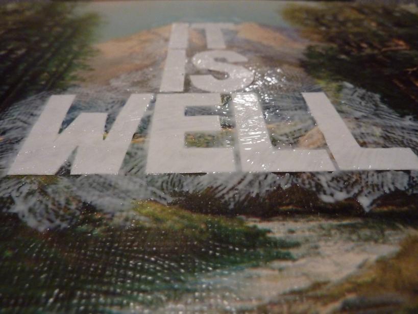 mod podge paper letters onto artwork