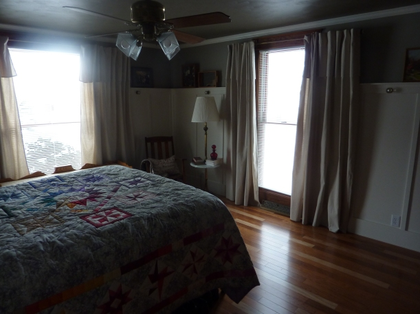 ceiling fan, quilt, board and batten and dropcloth curtains