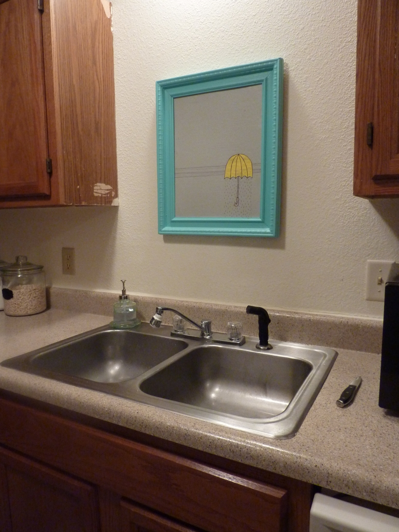 umbrella art over sink in kitchen