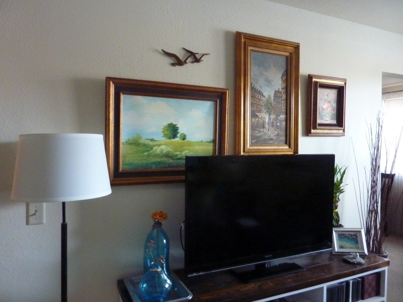 living room gallery wall oil paintings