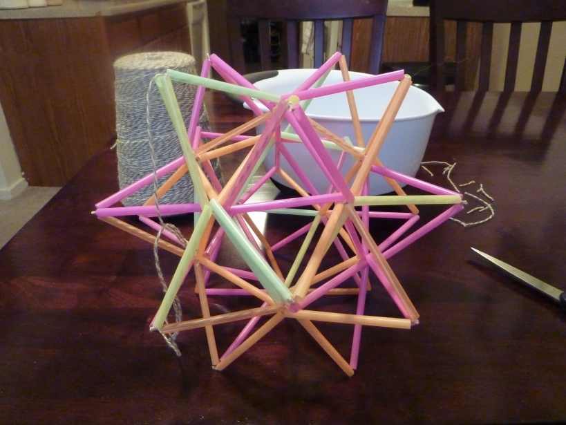 geometric himmeli-style star made out of straws and string