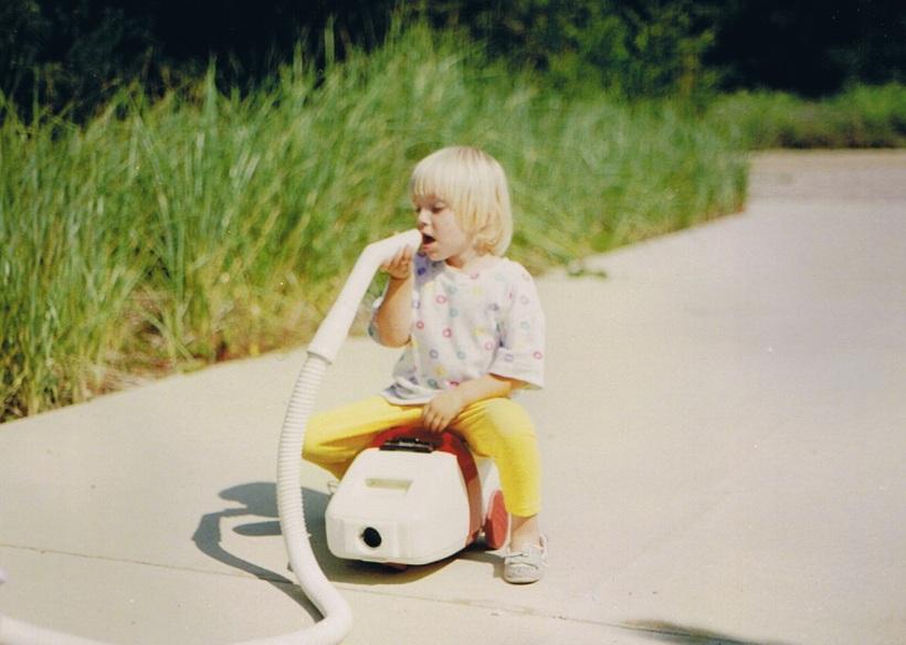 kid riding vacuum