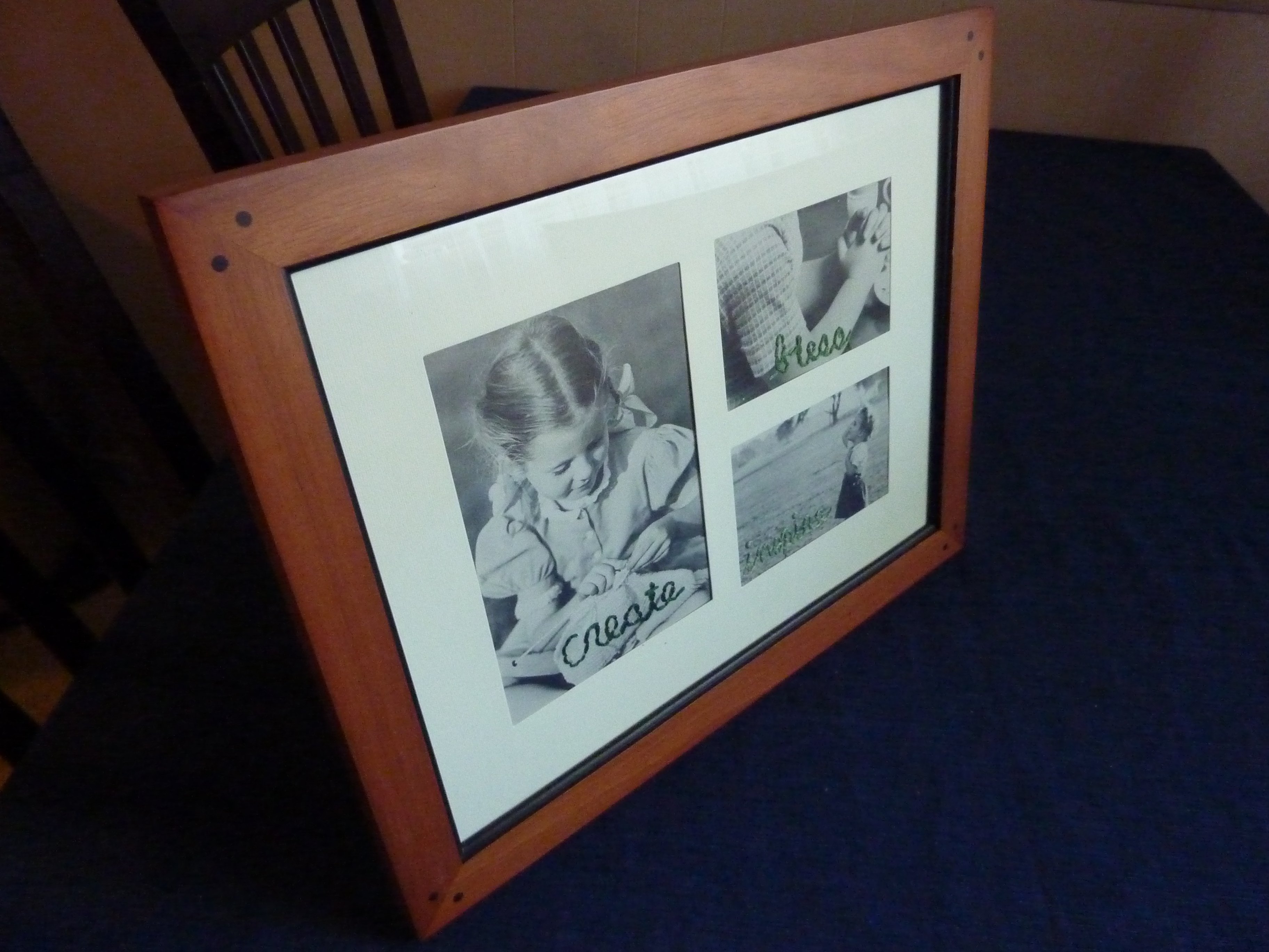embroidered black and white photos in frame