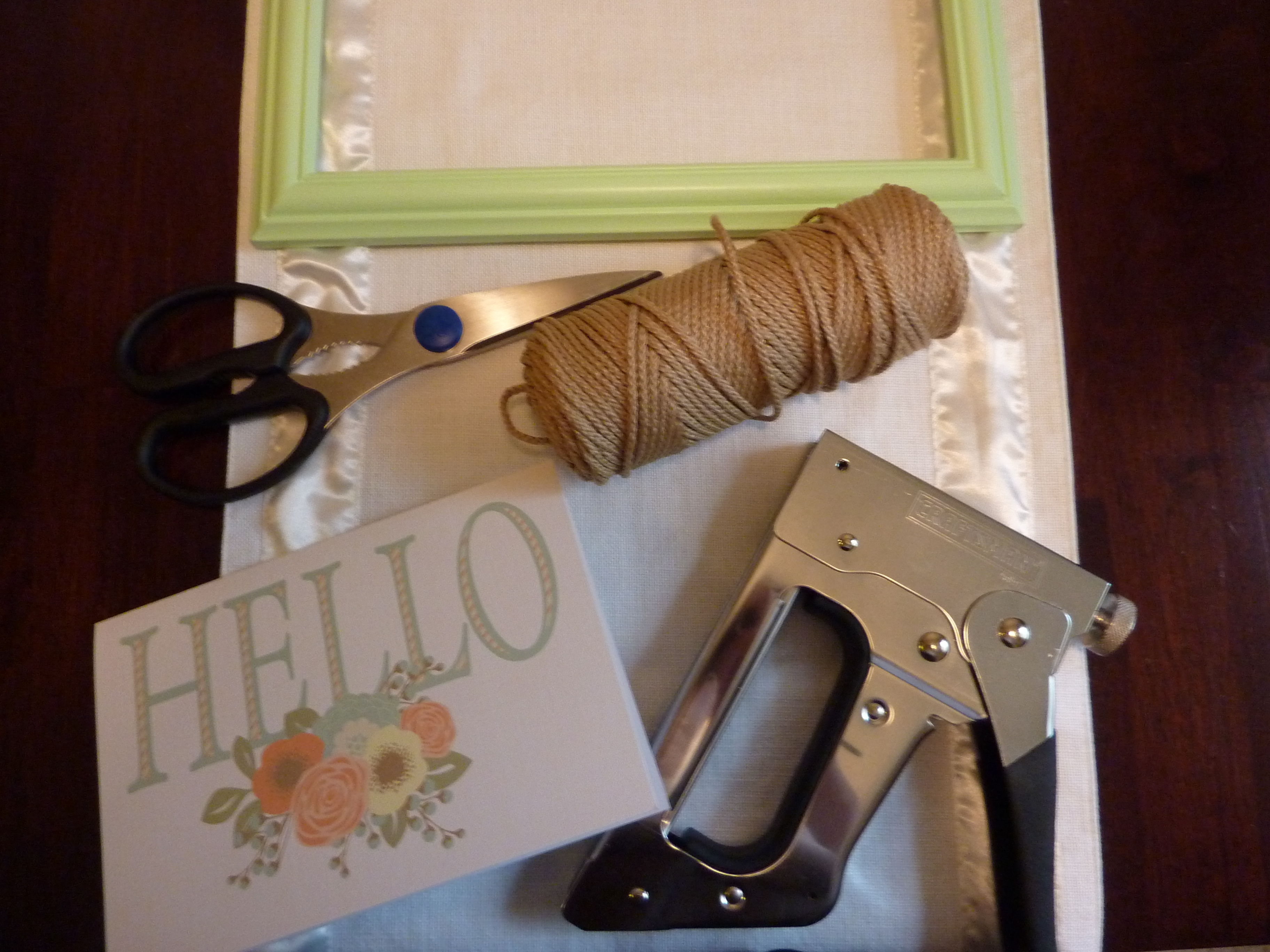 Hang a card in a frame.