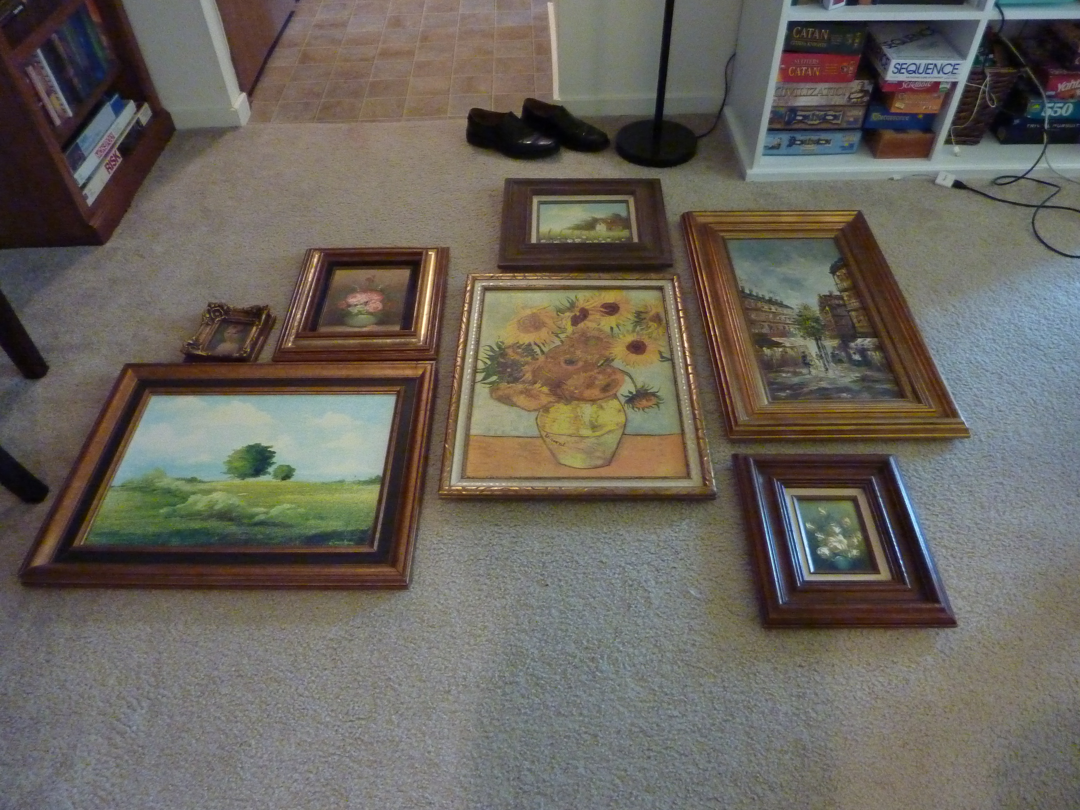 Oil painting gallery wall layout.