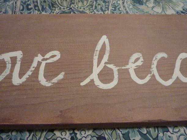 distressed paint on barn wood sign