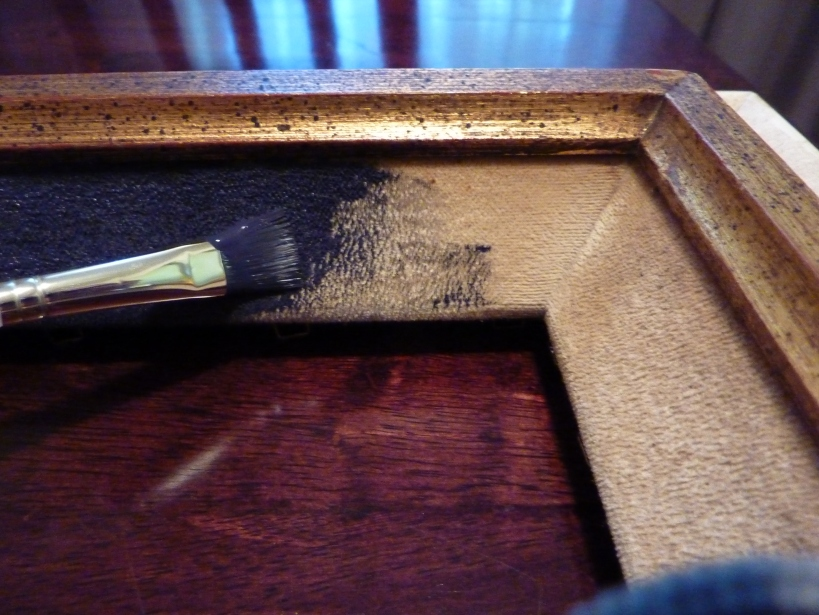 Paint a thrift store frame's velvet section with craft paint.